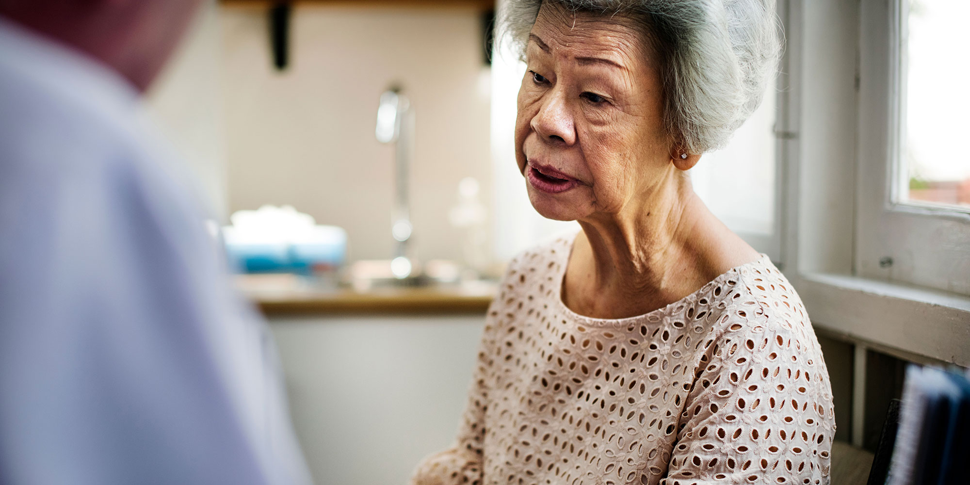 Elderly woman talking to case manager